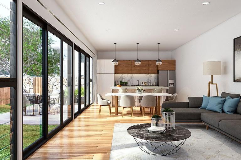 Rendering interni, open space con divano e cucina a vista con ampia porta a vetri e giardino