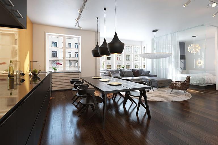 Rendering interni, open space appartamento classico con pavimento il parquet, cucina a vista tavolo da pranzo divano moderno grigio e baldacchino con letto.