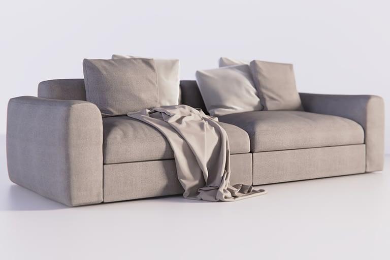 Rendering di prodotto, divano colore grigio con cuscini e coperta