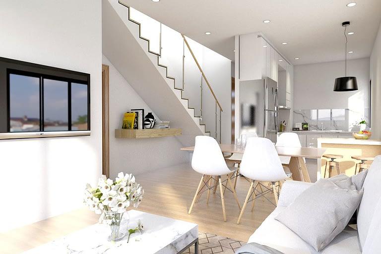 Rendering interni, open space appartamento su due piani sala soggiorno con cucina a vista e scale che portano al secondo piano.